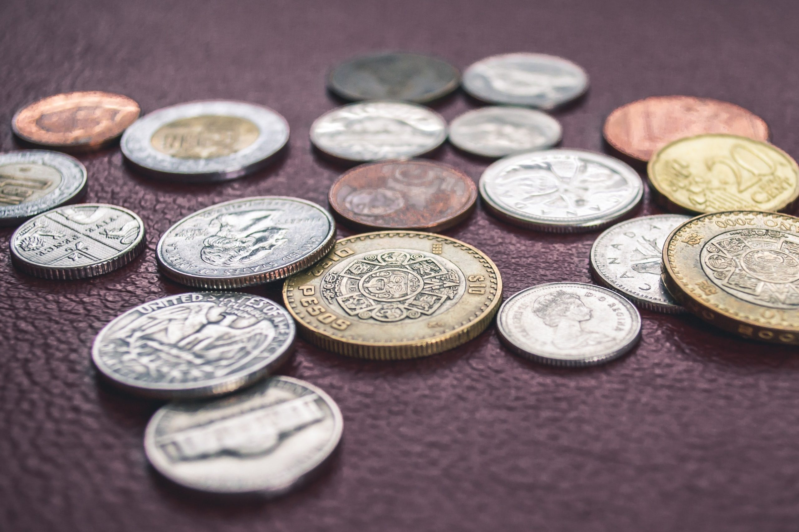 various coins on table Private Loan Lenders UK