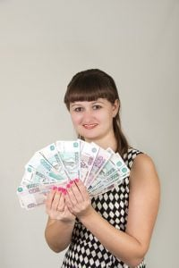 12 Month Payday Loans direct lenders girl holding cash in front of face