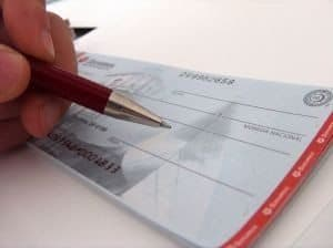 Bad Credit Personal Loans UK writing a cheque