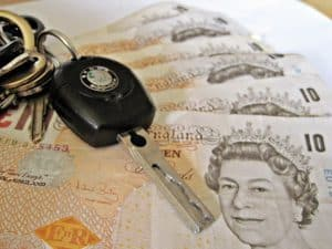 Calculate A Car Loan car keys sitting on cash notes