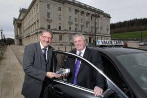 Car Finance NI sammy wilson with christopher mccausland at stormont belfast