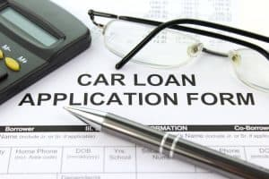 Car Payments Calculator loan application form and pen