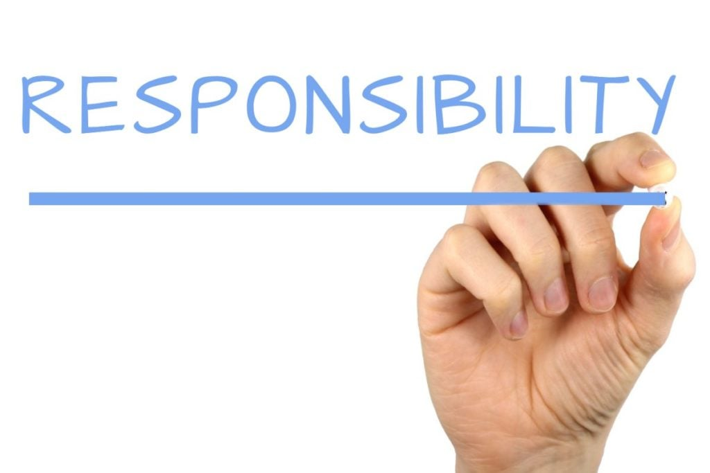 responsible lending quick and friendly loans blue writing on glass