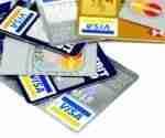 black diamond credit card pile on table