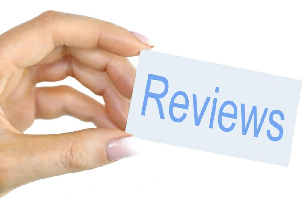 freedom finance loans reviews hand holding card
