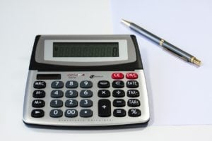 personal loan calculator on desk with pen