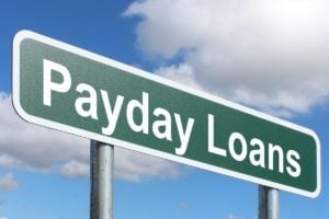 payday loans road sign