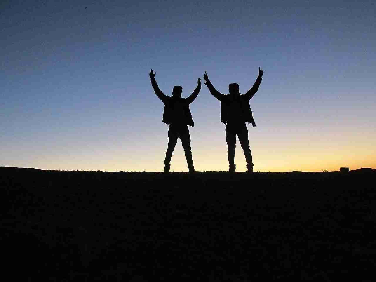amigo guarantor loans two friends on mountain top