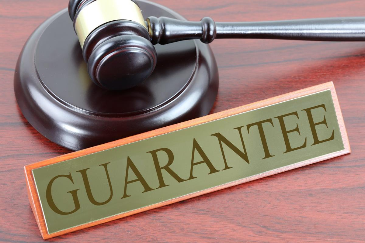 guarantor lenders like amigo hammer and gavel with guarantee sign