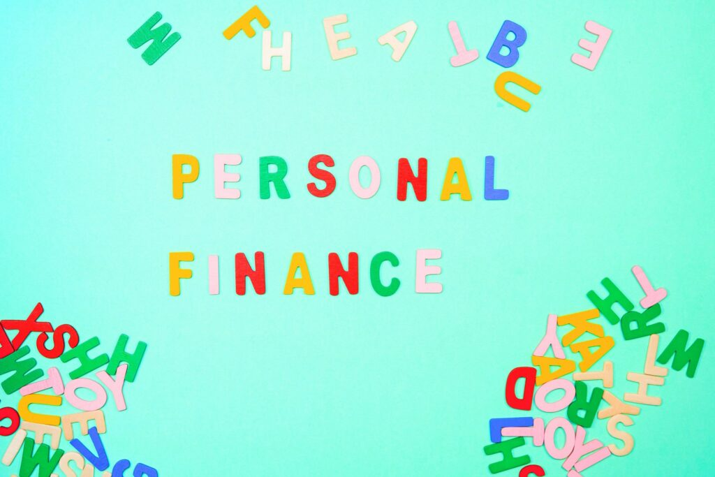 covid 19 affecting personal finance coloured letters on board