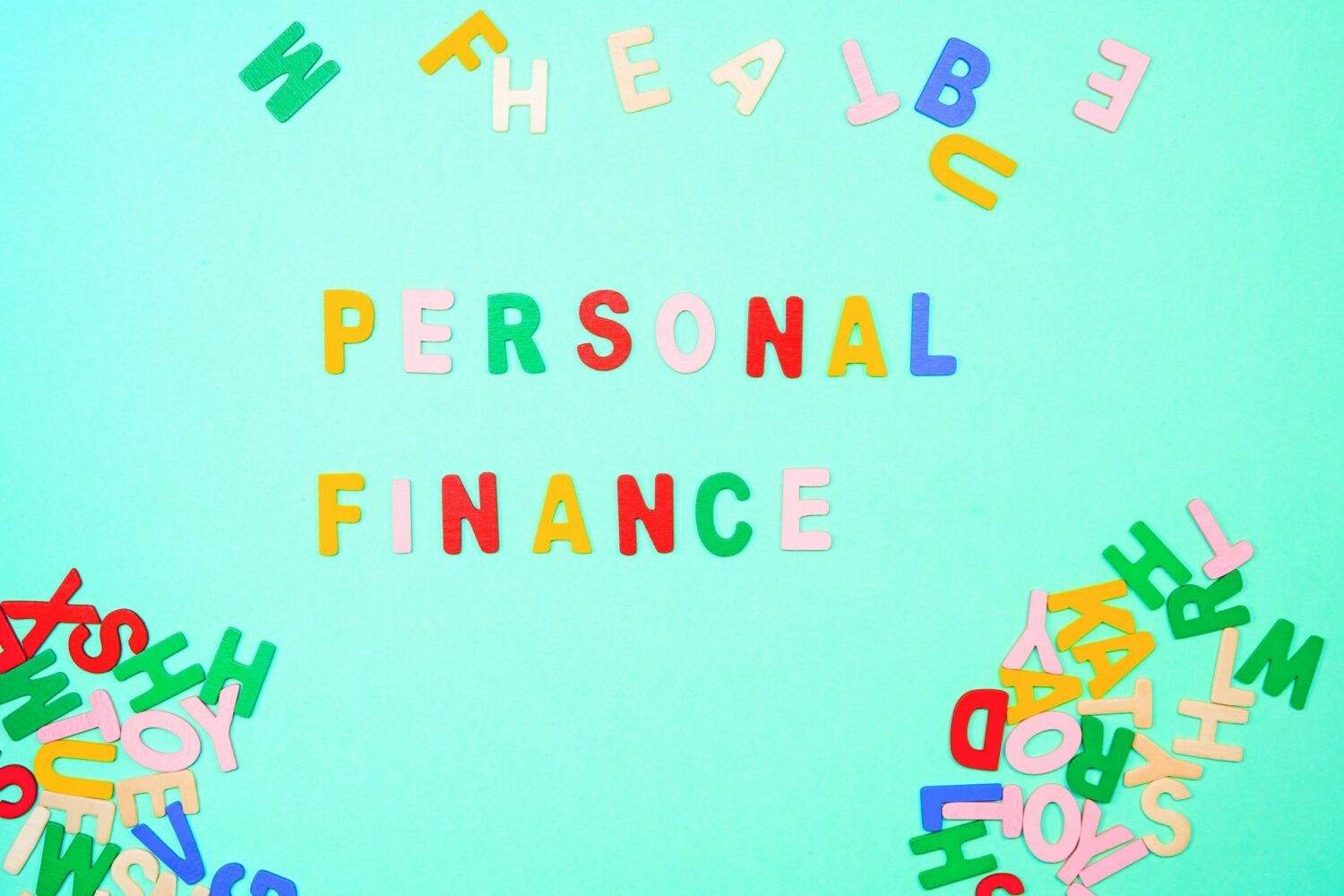 covid-19 affecting personal finance coloured letters on board