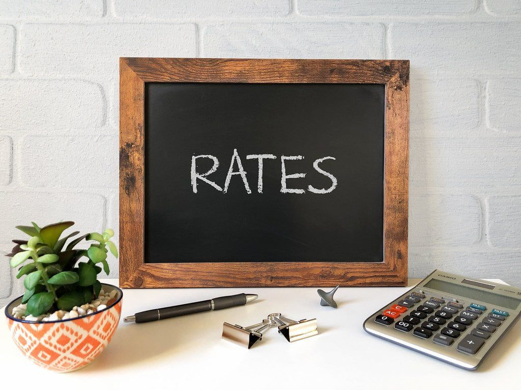 blackboard with the word rates written in chalk best rate loans