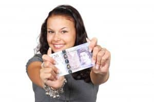 Small Cash Loans smiling girl holding cash in hands