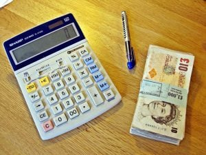 Cash Advance Loans Online Direct Lenders cash calculator pen on desk