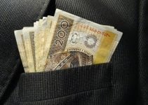 Cheap Short Term Loans money sticking out of top suit pocket