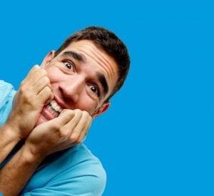 desperately need a loan man clenching teeth in desperation