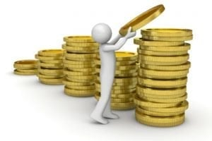 fast cash loans today figure stacking gold coins
