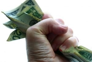Fast Personal Loans fist grabbing cash notes