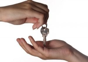 dropping house keys into open hand