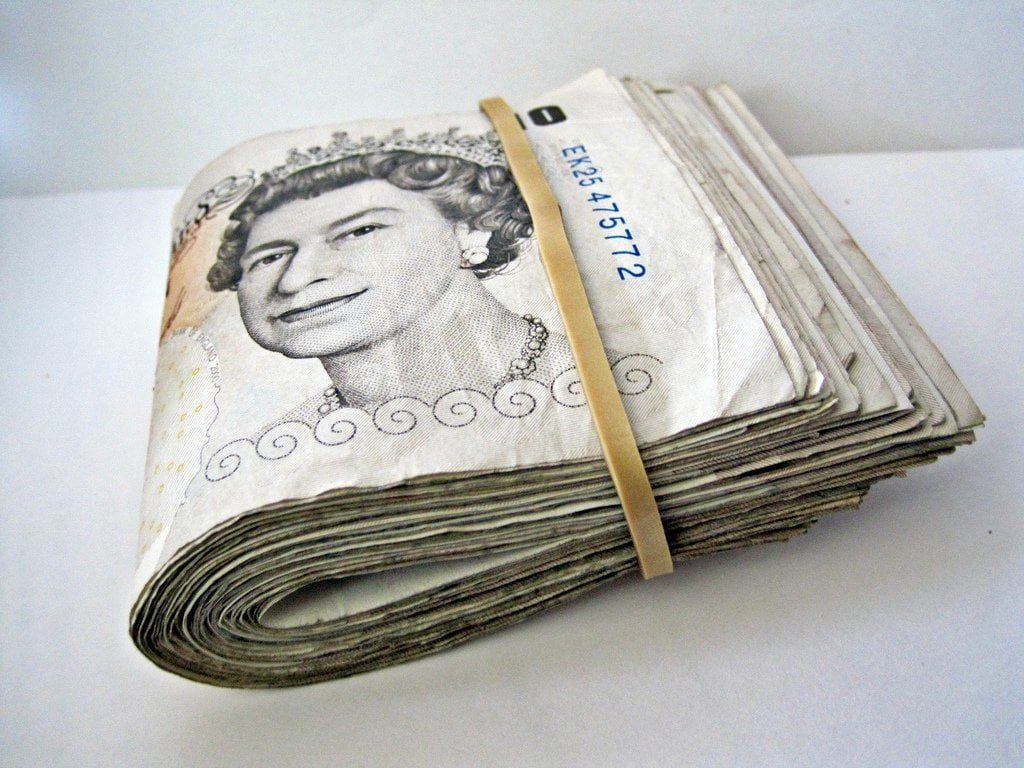 need borrow 50 pounds used cash notes in a bundle with rubber band around