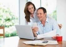 new loan fast couple on laptop getting new loan sorted