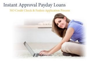new payday lenders girl on laptop smiling at getting cash online