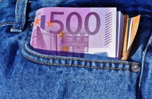payday loans for bad credit cash in jeans pocket sticking out