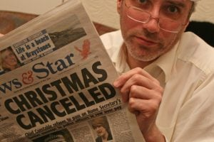 paying off your credit card bill after christmas cancelled man reading newspaper