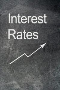 personal loan interest rates increasing arrow on blackboard