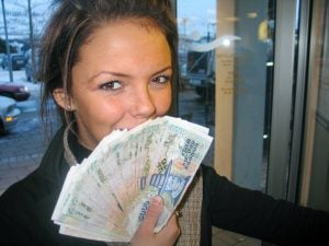 girl smiling with cash in hand