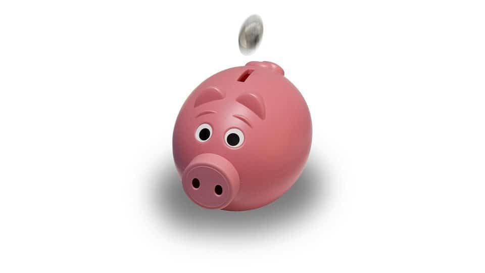 Top Loans for Bad Credit pink piggy bank coin being dropped in